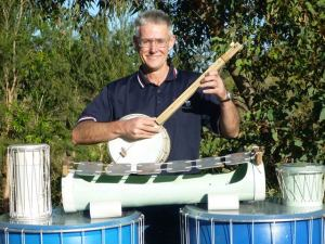 Alec Duncan, the music man, with homemade instruments, banjo, metallophone, drums
